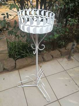 Lovely old tall, metal plant stand.