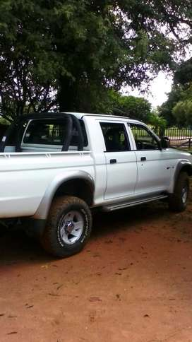 Is V6 colt 4x4 bakkie white in a good condition 2001 model