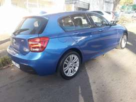 BMW 118I WITH SUN ROOF IN EXCELLENT CONDITION, PRICE NEGOTIABLE