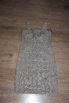 Sukienka w kratkę z bolerkiem