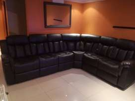 Brand New Leather corner lounge suite with console and two recliners.