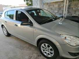 Opel Astra, 2008 model it is 12 years. It is metallic silver.