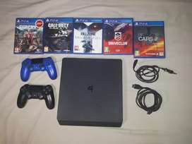 Ps4 slim with two remotes and games