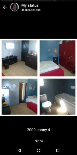 Room with fitted wardrobe, toilet and bath