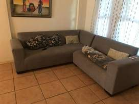 An L-shaped grey couch