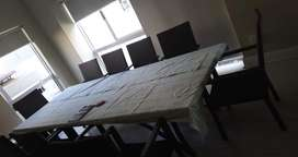 Complete dining table with 12 chairs, Excellent condition.