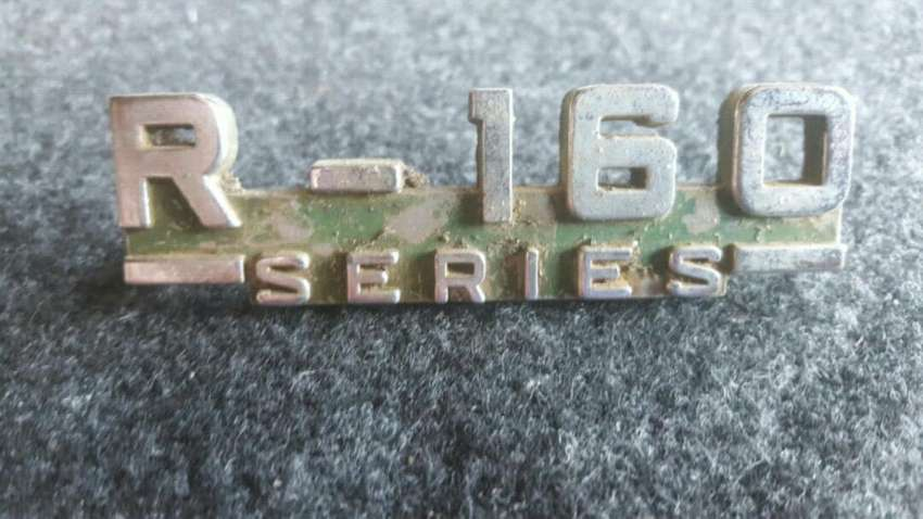 R-160 series badge 0