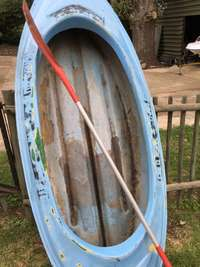 Image of canoe paddle boat with oar