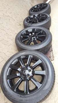 Image of Set 20 Inch Original Landrover Discovery 4 Black mags with Pirelli Sco