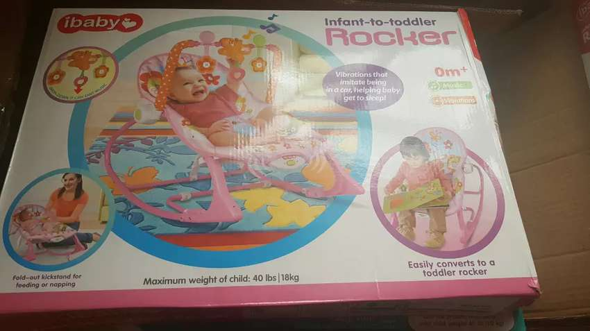 Infant to Toddler Baby Rocker with Musical Toy Bar & Vibrations- pink 0