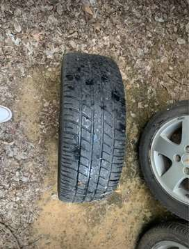 3 original 15 inch chevy spark wheels for sale