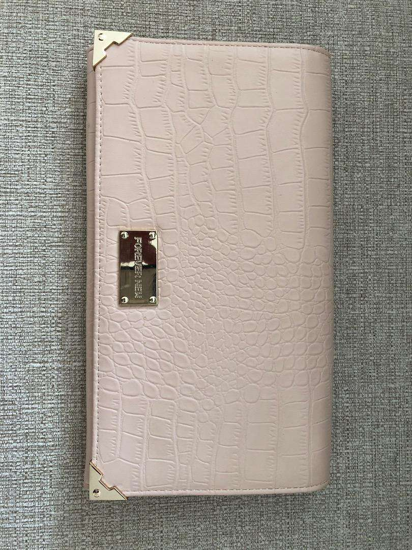 Pale pink crocodile leather patterned clutch bag
