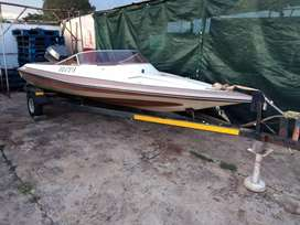 Boat on trailer and motor