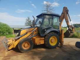 Case 570 T4WD LS TLB with Hammer