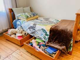 Single solid wood bed with large pull out storage drawers