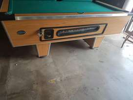 Coin operated pool table. Fast cloth takes R2 coins.