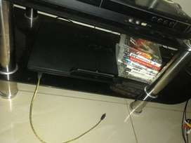 Ps3 with 2 remotes & games for sale