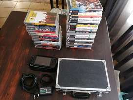 PSP + 20 Games + 15 Movies + Accessories