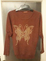 Ciekawy sweterek M/L