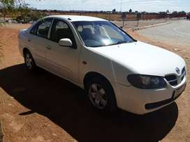 Nissan almera in good running condition on the road with papers