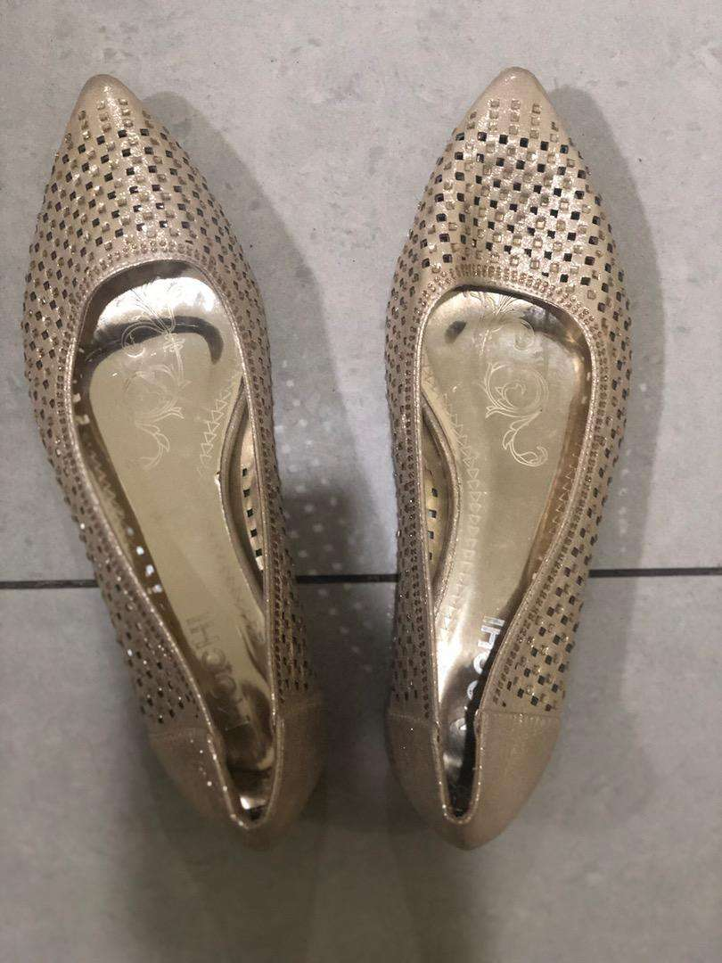 Golden pair of shoes 0