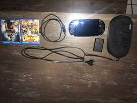 PSVita with Original Chargers, Carrier Case and 2 Games