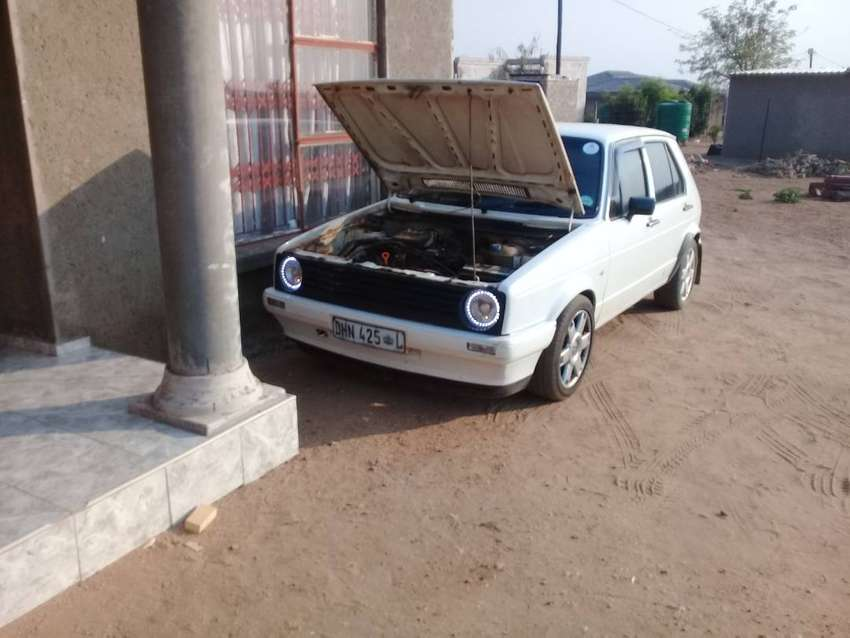 VW golf 1 white in color. FOUR door car. 0