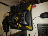 Image of Xboks 360 with hdmi and 2remotes head phones still works