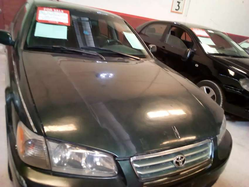 A clean green Toyota Camry  2000 model Nigerian used car for sale. 0