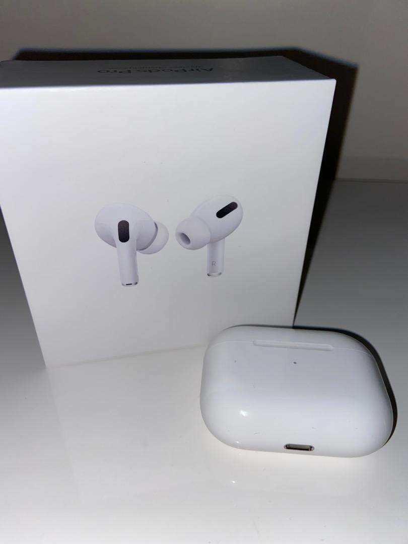 AirPods Pro with wireless charging case, cord and box