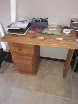 Desk with drawer and cabinet.