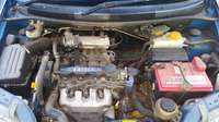 Image of chevrolet aveo 1500 blue 142000 on the clock