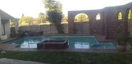 2 bedroom house to rent in elandspark shared property with pool.braai