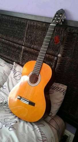 Never been used before nylon string acoustic guitar