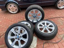 BMW Rims with center caps and new tyres R8000 or negotiable