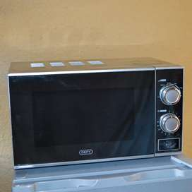 New Defy 20L Microwave Mirror Oven, used for a week