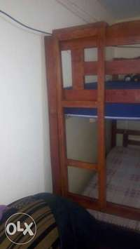Its a hardwood bed still new two months old 0