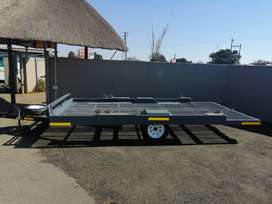 Large flat trailer with ramps