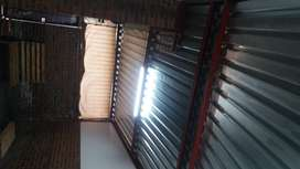 9m by 4m steel structure with roofing and gates