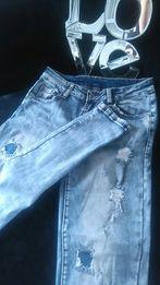 Elastyczne jeansy z przetarciami 36