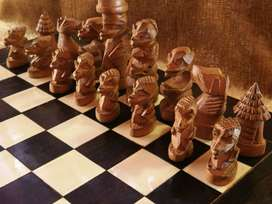 African carved chess set