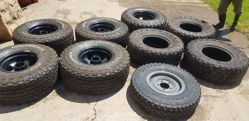 Land cruiser mags and tyres, spare wheel,and carier 0