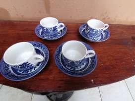 Set of 4 Churchill blue and white cups and saucers.