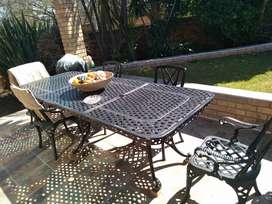 Cast iron table with chairs and covers