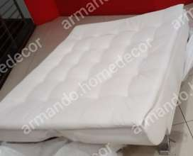 White faux leather sleeper couch