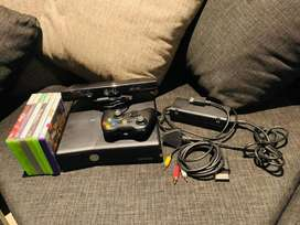 Black Xbox 360, one controller, kinect and 6 games