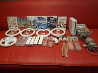 Image of Wii console,accessories and 9 games