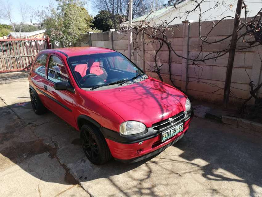 I selling opel corsa 1.3 sport model R30 000.and Flat-screen tv and dv 0