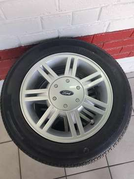 """Original 14"""" Ford Mags with tyres For Sale."""