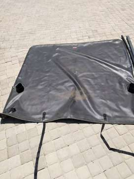Ford double cab roll bar and tonique cover only for sale.